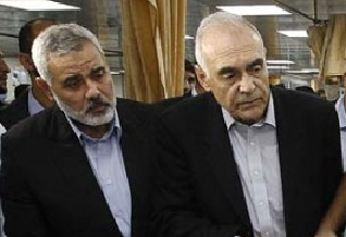 Mohamed Kamel Amr with Gaza's  Ismail Haniyeh