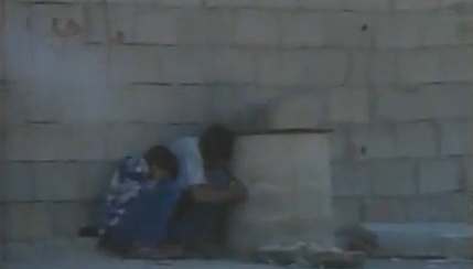Mohammed al-Dura cowering behind his father's back - Screenshot
