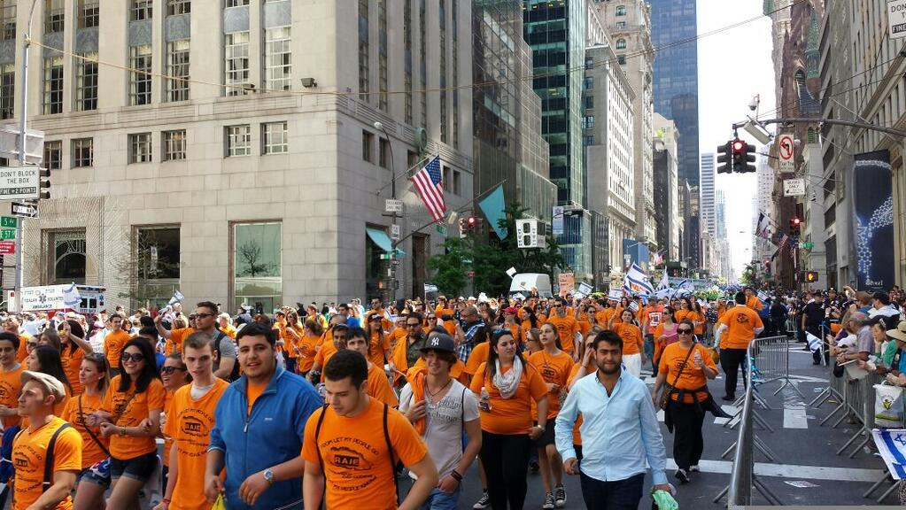 A sea of orange, the RAJE float is marching #TogetherOnFifth - Twitter