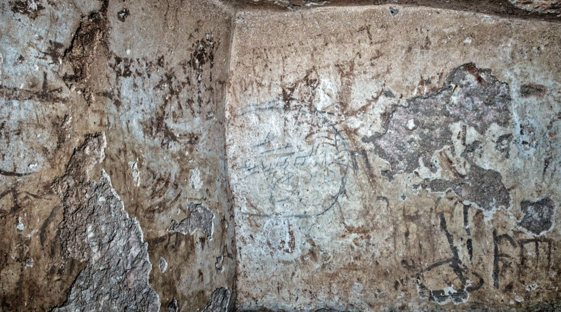 Writing & images were daubed onto the walls using mud & soot, though some were carved.Photo courtesy: Shai Halevy/Israel Antiquities Authority