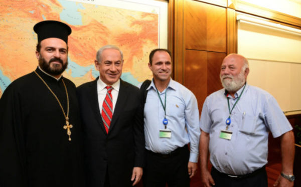 (Father Gabriel Naddaf with) Lt. (Res.) Shadi Khalloul (seen standing on Netanyahu's left) has been interviewed by and written for Israel Today on several occasions.
