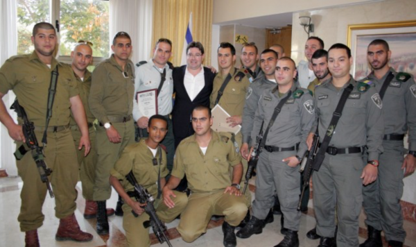 Some of the Christian IDF soldiers (Left) and Border Guard Police (Right) who attended the Israeli Christians Recruitment Forum.