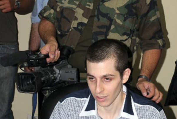 Hamas rejected Red Cross requests to see abducted IDF soldier Gilad Shalit, is shown here with a Hamas terrorist's hand on their prisoner's shoulder during a forced interview. - Hamas.