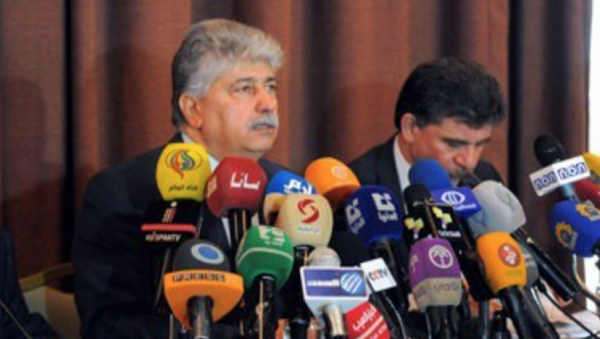 Ahmad Majdalani (left) speaks to the press - Syrian News Agency