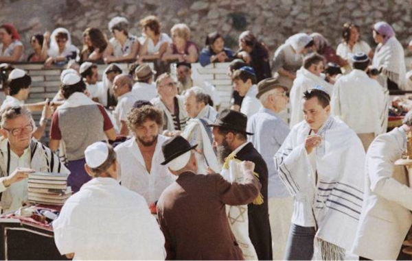 Bob Dylan, (3rd from left) with his son Jesse, in the white tallis on right, at the Western Wall in September 1983. - Photo: Facebook