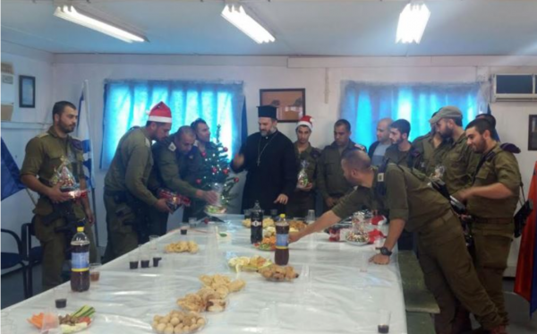 Father Naddaf of Nazareth with Christian Israeli IDF soldiers at a Christmas party on December 21, 2015. - Photo: ISRAELI CHRISTIAN RECRUITMENT FORUM