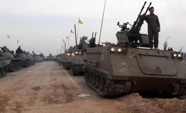 Hezbollah's shows US made APCs in first-ever military parade on foreign soil, held in the Syrian city of Qusayr.