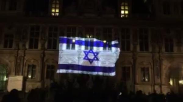 Paris city hall bears Israeli flag to honor victims of Jerusalem terror attack - i24news screenshot